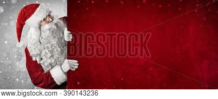 Santa Claus Holding Blank Advertisement Banner Red Background with Copy Space