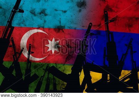 Several Automatic Rifles Raised Up On The Background Of The Azerbaijan Armenia Flag