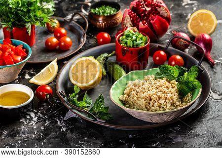 Tabbouleh Salad. Middle Eastern Or Arab Dish. Levantine Vegetarian Salad With Parsley, Mint, Bulgur,