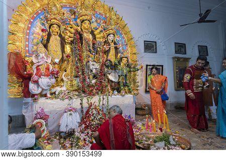 Kolkata, West Bengal, India - 6th October 2019 : Hindu Purohit Uttering Sanskrit Shlokas For Pushpan