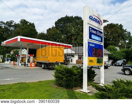 NORWALK, CT, USA-AUGUST 15, 2020: Global local gas station in Post Road 1 near exit 14 on I-95