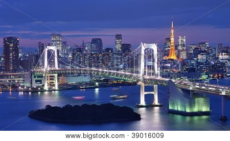 Rainbow Bridge spanning Tokyo Bay with Tokyo Tower visible in the background.