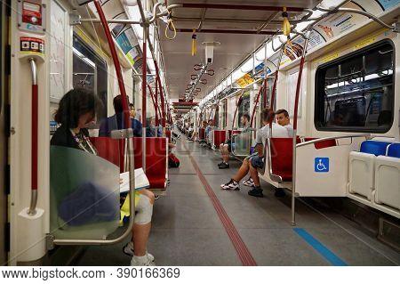Toronto, Canada - 2016 06 27: Passengers In The Cabin Of Ttc Subway Car. Toronto Transit Commission