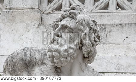 Old Scultpture Of Zeus Beside National Monument To Victor Emmanuel Ii In Rome Italy