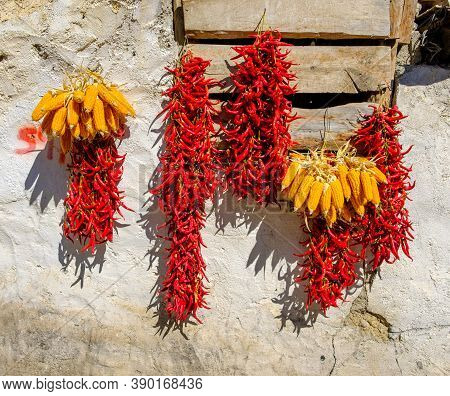 Peppers Drying Outside As Traditional At Wall