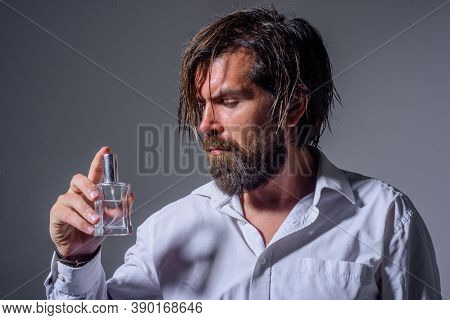 Bearded Man Holds Bottle Of Perfume. Cosmetics. Scent Cologne Bottle. Masculine Perfume. Man Perfume