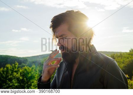 Smoking Hipster. Bearded Man Smoking Outdoor. Cigarette Smoke. Tobacco. Bearded Man With Cigarette.