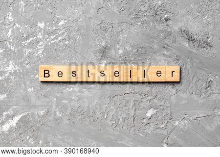 Bestseller Word Written On Wood Block. Bestseller Text On Table, Concept