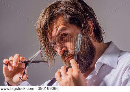 Handsome Bearded Man With Barber Tools. Professional Beard Care. Barber Razor. Scissors. Barbershop.