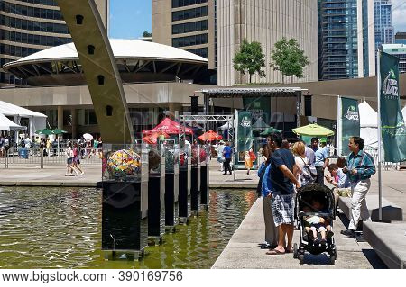 Toronto, Canada - 06 27 2016: Torontonians On Nathan Phillips Square Contemplate Part Of The Brains