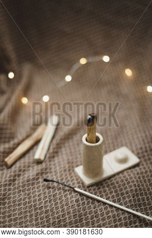 Palo Santo Stick On Fire With Smoke In A Beautiful Candlestick. Healing, Meditation, Relaxation, Pur