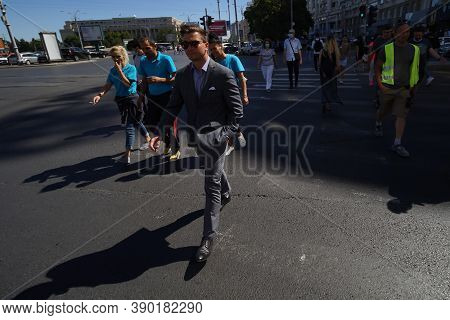 Bucharest, Romania - September 01, 2020: People Cross The Street Near Victory Square In Bucharest, R