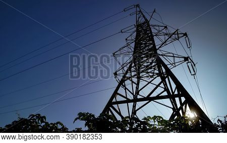 Bucharest, Romania - September 22, 2020: A High Voltage Pole Can Be Seen Against The Background Of T