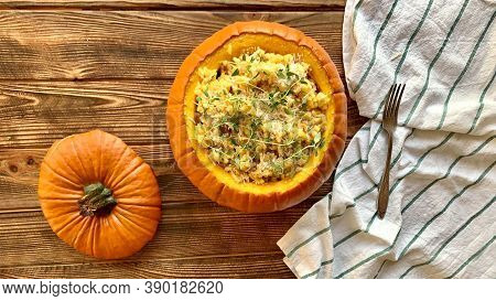 Pumpkin Risotto On Rustic Backgroung. Bright Warm Colors. Seasonal Dish For Thanksgiving Day.