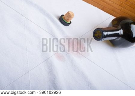 Turned Over The Bottle And Spilled Exquisite Red Wine On A White T-shirt. Place For Text