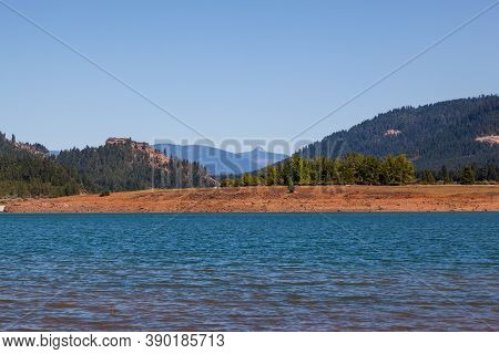 Looking Across The Surface Of Lost Creek Lake To Stewart State Park On The Embankment With Needle Ey