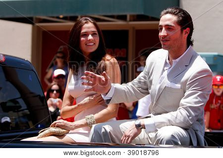 PHOENIX, AZ-JULY 12: Milwaukee Brewers outfielder Ryan Braun rides with girlfriend Larisa Fraser at the 2011 MLB Chevy All-Star Red Carpet Parade on July 12, 2011 in Phoenix, Arizona.