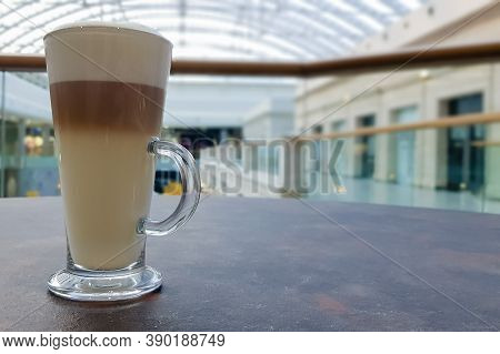 Classic Coffee Latte Macchiato In A Glass Cup On The Table. Glass Cup With Hot Drink.
