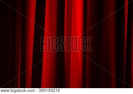 Bucharest, Romania - July 14, 2020: The Sun\'s Rays Illuminate The Folds Of A Red Curtain.
