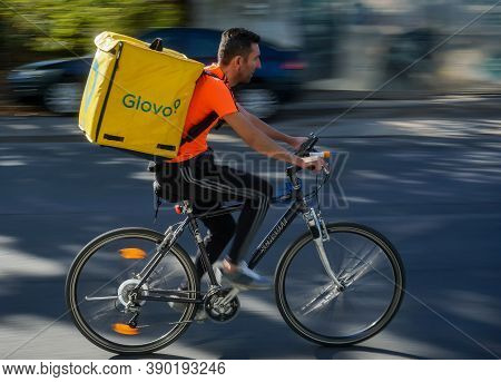 Bucharest, Romania - September 27, 2020: A Glovo Food Delivery Courier On A Bike In High Speed In Tr