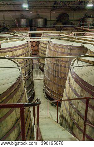 Vicuna, Chile - December 7, 2008: Destileria Capel, Pisco Dilstillery. Warehouse With Rows Of Maturi