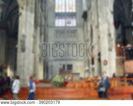 Defocused Photography. The Interior Of The Catholic Church Inside. Religious Holy Prayer. Blurred Ba