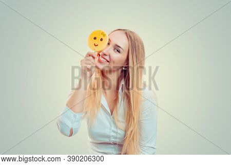 Blonde Haired Young Woman Girl Playing With Yellow Emoji Candy On A Stick Standing Isolated On Light