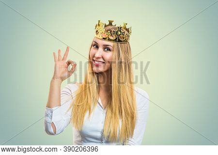 Everything Is Fine. Beautiful Young Woman In Birthday Party Golden Showing Ok, Okay Sign Isolated On