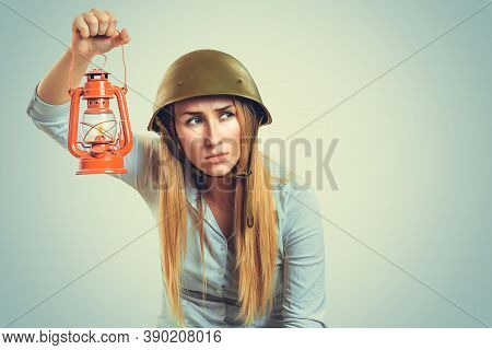Woman In Military Armor Cap Equipment Of World War Ii Period Holding Gaslight Searching For Friends