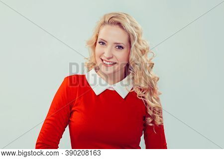 Front View Of Charming Blond Woman In Red Dress Smiling Looking At Camera, Toothy Smile On Face. Cau