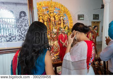 Kolkata, West Bengal, India - 6th October 2019 : Modern Sari Clad Devotee Woman With Goddess Durga P