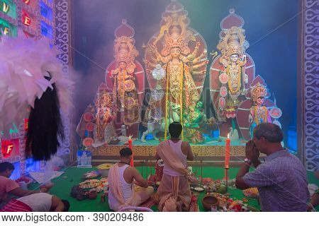 Howrah, West Bengal, India - 5th October 2019 : Hindu Bengali Purohit And Devotee Parying To Goddess