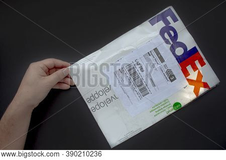 Calgary Alberta, Canada. Oct 17, 2020. A Person With A Fedex Package. Concept: Shipping Packages