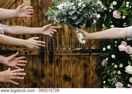 Hands Reach For A Wedding Bouquet,female Hands Try To Catch The Bride's Wedding Bouquet,the End Of T