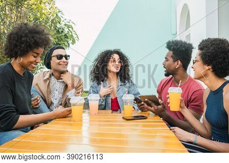 Afro Friends Having Fun Together While Drinking Fruit Juice.