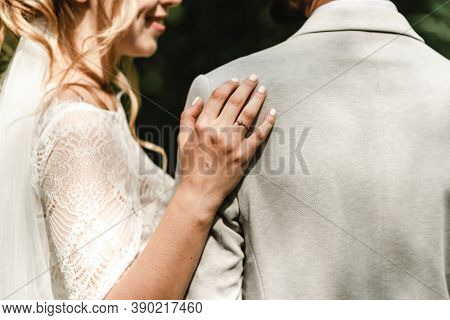 Wedding Couple In The Park,european Bride And Groom Kissing In The Park,happy Bride And Groom At A P