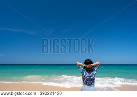 Woman Rise Hands Up To Sky Freedom Concept With Blue Sky And Summer Beach Background.