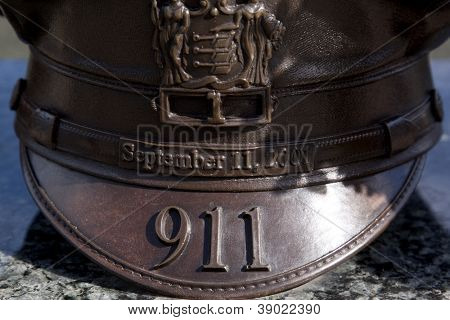 W. ORANGE, NJ-SEPT 11: A bronze sculpture of a policeman's hat in the 911 memorial inside Eagle Rock Reservation honors victims of the 2001 terror attacks on September 11, 2012 in West Orange, NJ.