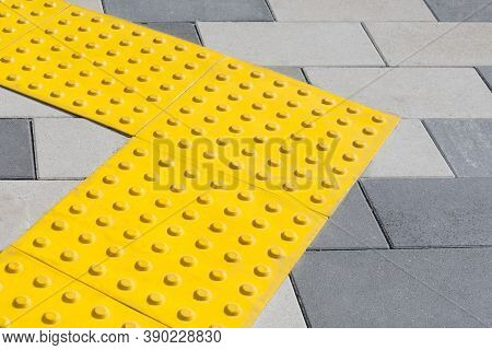 Yellow Blocks Of Tactile Paving For Blind Handicap. Braille Blocks, Tactile Tiles For The Visually I