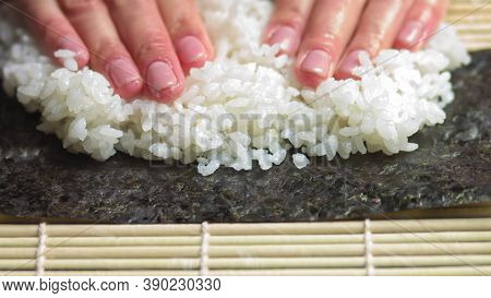 Spreading Cooked Sushi Rice On A Seaweed Wrap - Sushi Making - Close Up, Slow Motion.sushi Chef Spre