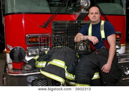 Firefighter And Fire Truck