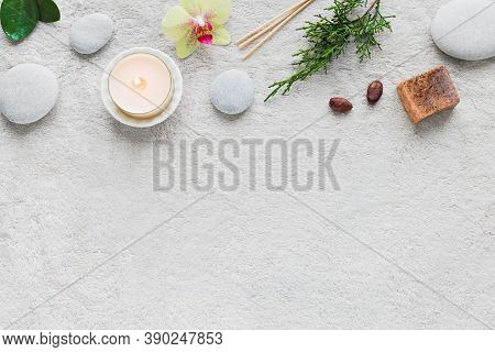 Natural Skin Care And Spa Set On White Soft Towel Background With Natural Cosmetic Products, Flower,
