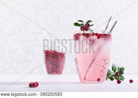 Fresh Healthy Lemonade With Red Bilberry, Ice,  Green Berry Leaves On White Wood Table, Copy Space.