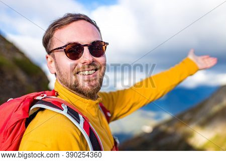 Snow White Smiling Man With Braces In Mountains . Concept Of Teeth Care Far From Home
