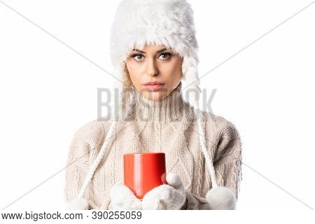 Pretty Girl In White Winter Hat Holds A Red Cup With Hot Tea On The White Background. Winter Concept