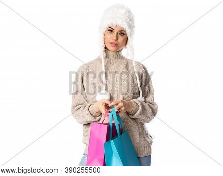 Happy Woman Holding Shopping Bags. Winter Sales Isolated