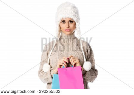 Happy Woman Holding Shopping Bags. Winter Sales. Isolated