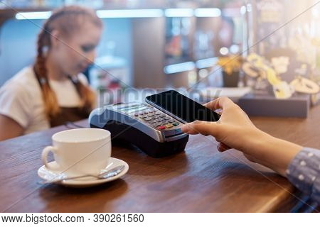 Faceless Woman Customer Paying In Cafeteria Via Contactless Way, Unknown Female Holding Smart Hone N