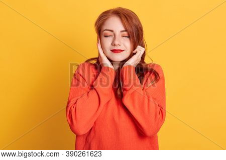 Red Haired Woman Plugging Ears With Fingers And Closing Her Eyes, Not Wanting To Listen Hard Loud Mu