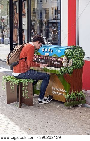 Bristol, Uk - August 17, 2017: A Man Plays A Piano Which Is Part Of